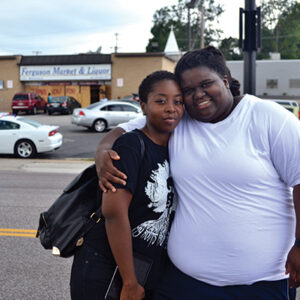 M. Adams (right) in Ferguson, Missouri.